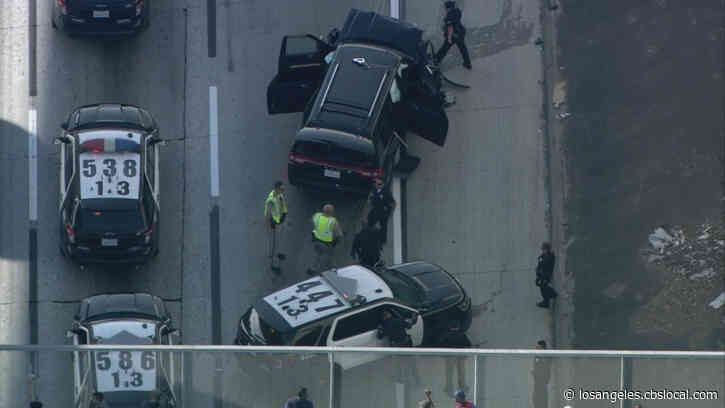 LAPD Pursuit With Stolen Hearse Ends In Wreck On South LA Freeway; Casket, Body Found Inside