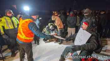 Police deliver injunction to demonstrators blocking rail tracks in Saint-Lambert - CTV News