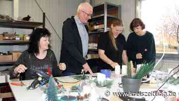 Mitarbeiter der Delme-Werkstätten in Sulingen bereiten den Wintermarkt vor - kreiszeitung.de