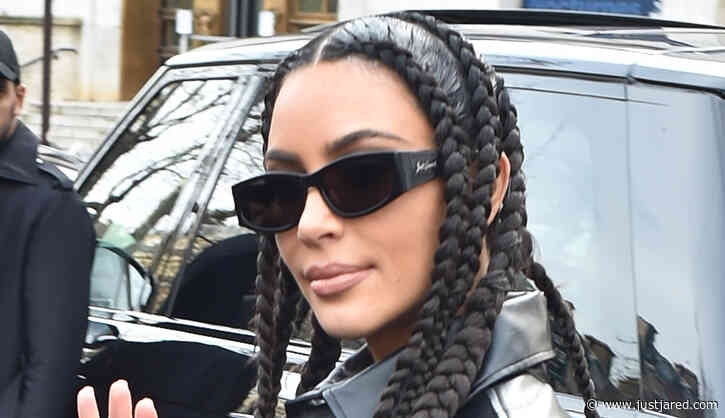 Kim Kardashian Sports Black Leather Look With Snakeskin-Print Boots While Leaving Paris