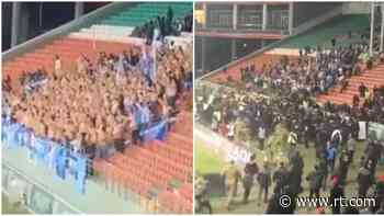 Culture clash: Shocking scenes as football fans in Grozny charge at rival Zenit supporters over 'insult to local customs' - RT