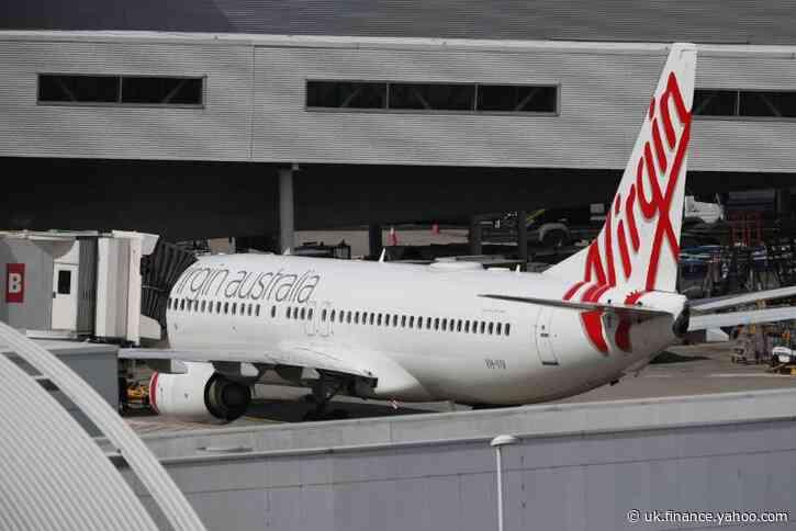 Virgin Australia plans to cut more domestic flights as travel restrictions tighten