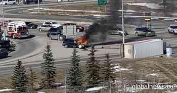 Man seriously injured in fiery Calgary crash involving postal truck