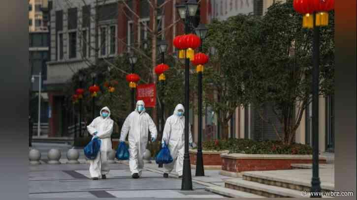 China prepares to lift travel bans after five days of no new virus cases in Wuhan