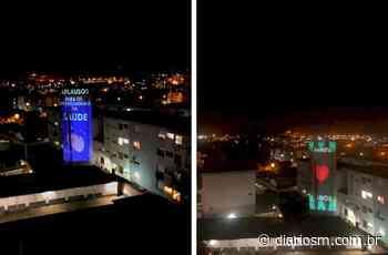 Imagens iluminam prédio de Santa Maria sob aplausos dos vizinhos - Diário de Santa Maria