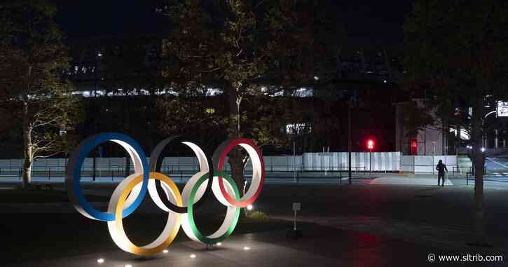 A virus rages, a flame goes out: Tokyo Games reset for 2021