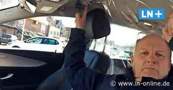 Corona - Coronavirus: Taxifahrer schützen sich mit einem Vorhang - Lübecker Nachrichten