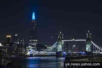 UK landmarks light up in blue to salute NHS staff battling coronavirus