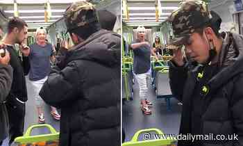 Disgusting moment racist mother hurls abuse at masked commuter in Melbourne