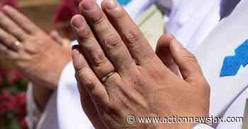 'Wash 'em': San Antonio hospital lights up phrase next to praying hands during coronavirus - ActionNewsJax.com