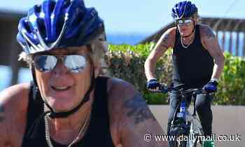 Rod Stewart, 75, goes for a spin on his bicycle in black singlet and leggings in in Florida