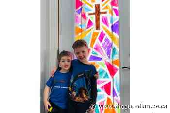 Families in Tignish paint their windows to reflect coming Easter season and to keep the kids busy - The Guardian