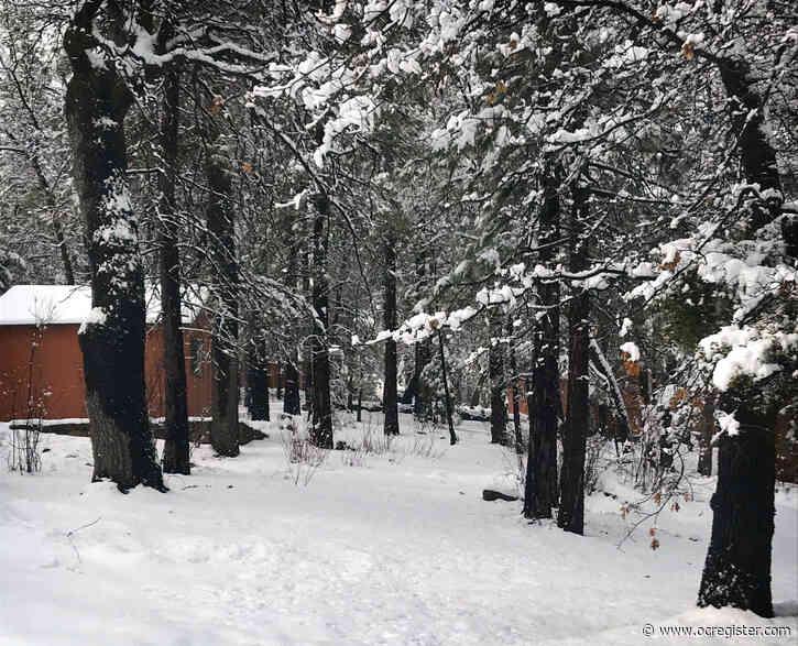 Coronavirus: Storm whitens the San Bernardino Mountains, but officials bar playing in the snow