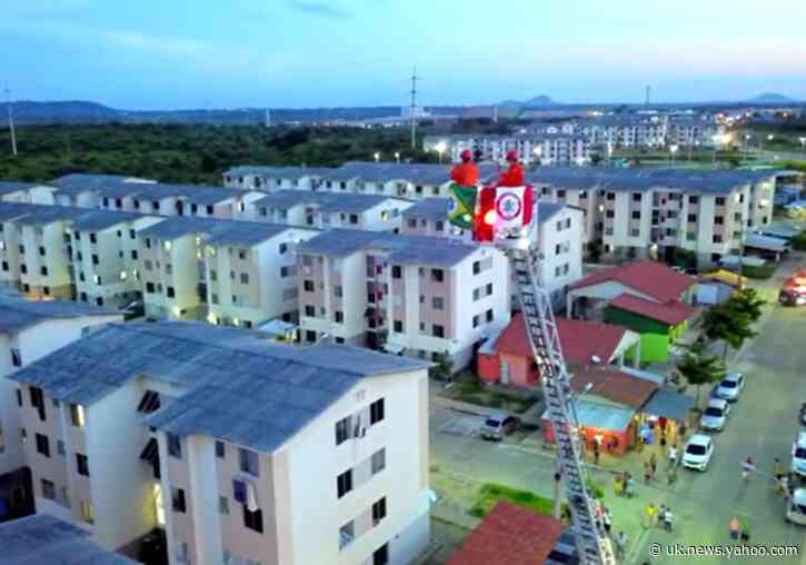 Brazil Firefighter Plays Trumpet From Crane Over Quiet Neighborhood