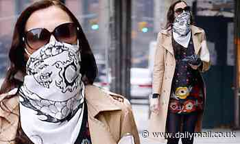Famke Janssen wears a handkerchief to cover her face and gloves amid coronavirus outbreak in NYC - Daily Mail