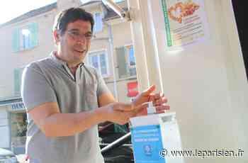 A Crosne, des distributeurs de gel hydroalcoolique installés devant les commerces - Le Parisien