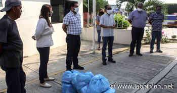 Apoyan a boleros y cargadores terrestres en Naranjos Amatlan - La Opinión