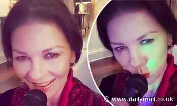 Catherine Zeta-Jones has a solo karaoke concert in her home amid lockdown - Daily Mail