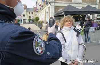 La police municipale prend la température des clients du marché à Mennecy - Le Parisien