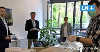 Corona - 10 000 kostenlose Schutzmasken werden auf dem Wochenmarkt Bad Schwartau verteilt - Lübecker Nachrichten
