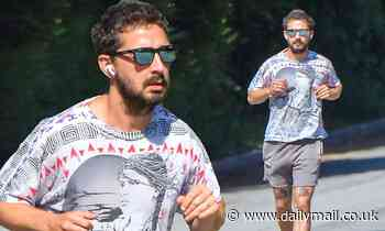 Shia LaBeouf cuts a casual figure in graphic print tee and shorts - Daily Mail