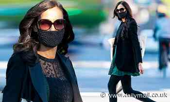 Famke Janssen pairs polka-dot mask with a turquoise and black mini-dress for walk in NYC - Daily Mail