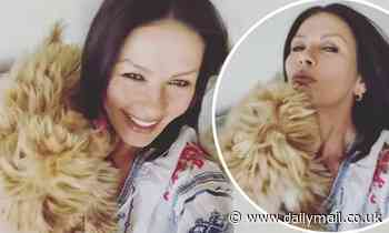Catherine Zeta-Jones is interrupted by her pet pooch Taylor in adorable video - Daily Mail