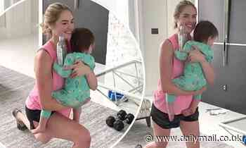 Kate Upton uses daughter Genevieve, 18 months, as a body weight - Daily Mail