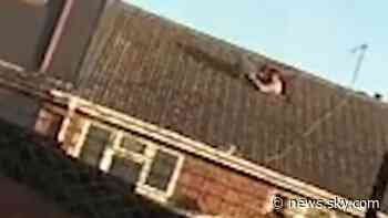 Birmingham: Man throws safe from roof as police raid home - Sky News