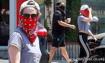 Kristen Stewart goes bandit chic in red bandanna with friends in LA during break from quarantine - Daily Mail