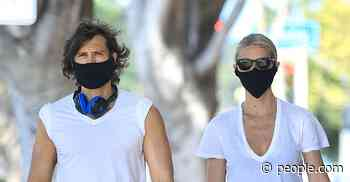 Gwyneth Paltrow and Brad Falchuk Color Coordinate Their Athleisure (and Face Masks) During Walk - PEOPLE
