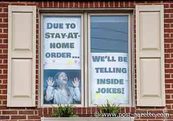 Signs in window of Mt. Lebanon home look on the bright side