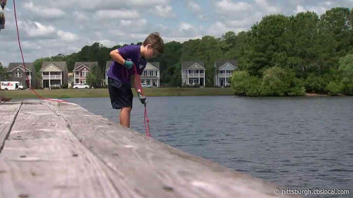 6-Year-Old Boy Finds Stolen Safe At Bottom Of Lake, Solves 8-Year-Old Mystery