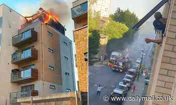Eighty firefighters are sent to blaze tearing through a block of flats in southeast London