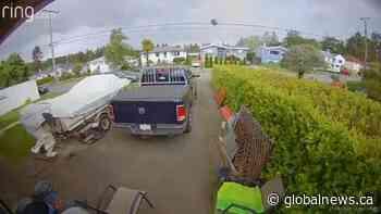 Tornado captured on Vancouver Island surveillance camera, tosses trampoline into air