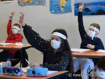 What the CDC guidelines for reopening schools recommend, including mask wearing and closing playgrounds