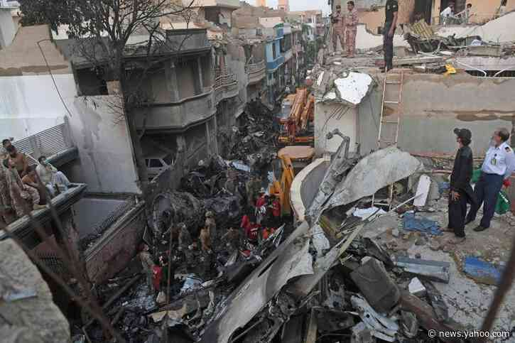Bodies from the sky: horror as plane crashes among homes in Pakistan