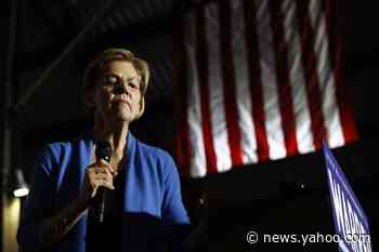 Biden strikes a populist tone but stops short of embracing Warren's economic plans
