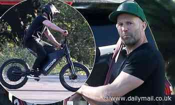 Jason Statham joins a male friend as they go for a ride on their new $8,500 electric bikes - Daily Mail