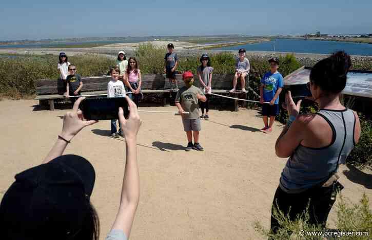 A small Huntington Beach class takes a socially distanced field trip