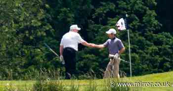 Donald Trump defies official coronavirus advice by shaking hands at golf course