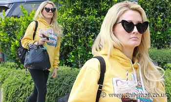 Holly Madison braves the open air sans mask for a weekend errand run with her precious pooch