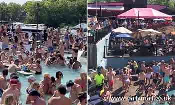 Hundreds ignore social distancing rules at crowded Memorial Day POOL PARTY in Lake of the Ozarks