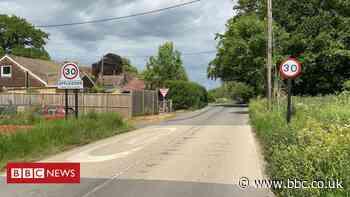 Murder arrest over body found in road near Ashford