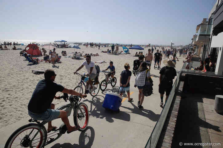 At So Cal beaches, heat, holiday and eased rules put more people on the sand