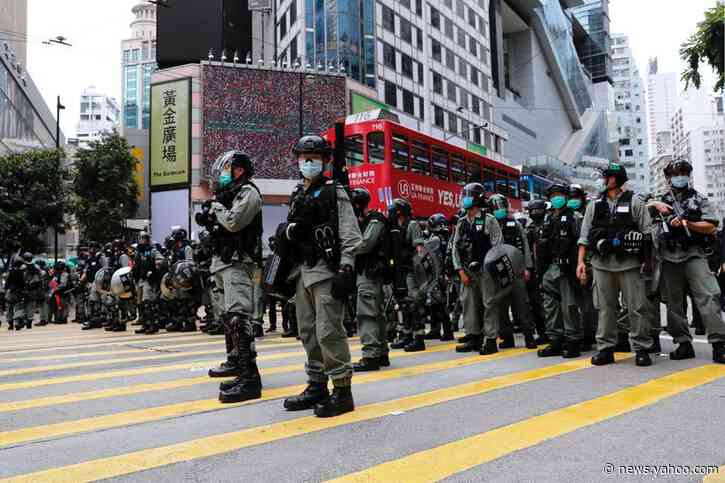Riot police reinforce Hong Kong legislature overnight as protests expected