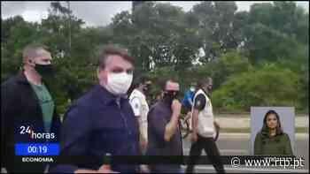 Covid-19 Brasil. Jair Bolsonaro esteve com manifestantes anti-confinamento em Brasilia. - RTP