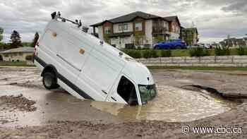City van responding to water main break plunges into sinkhole in Saskatoon