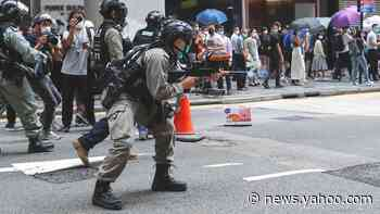 Hong Kong police fire pepper pellet at anthem protesters
