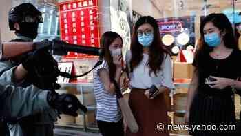 Hong Kong police arrest hundreds and fire pepper pellets amid fresh unrest